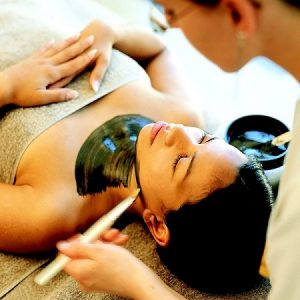 A Young Woman Taking Facial Detoxification By A Pro-Massage Therapist In A leading Massage Center.
