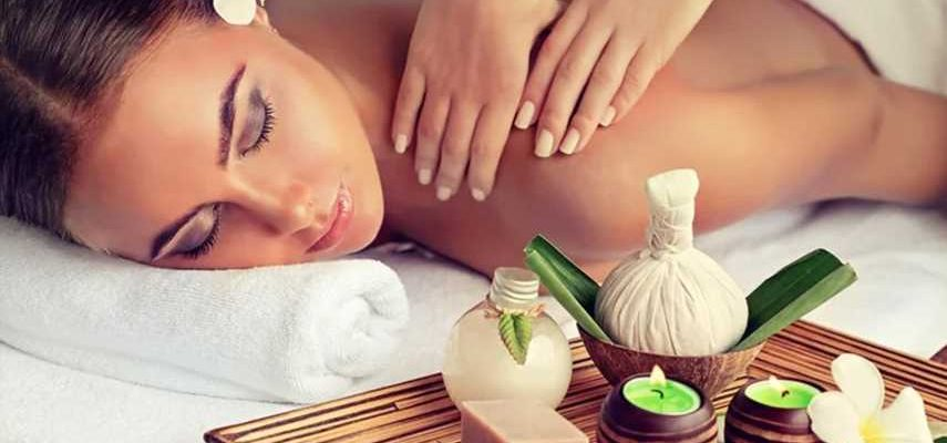 Pros & Cons Of Massage Services Concept - Woman Taken Massage In A Massage Center.