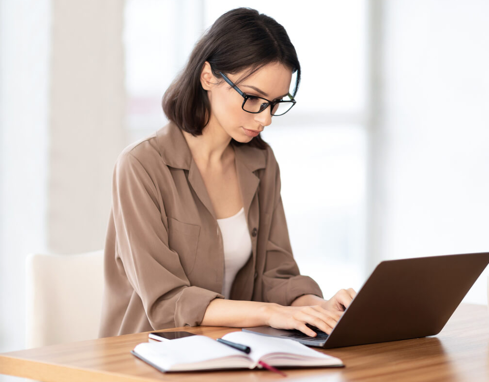 Portrait of Beautiful Young Woman Working At Home With Her Laptop.